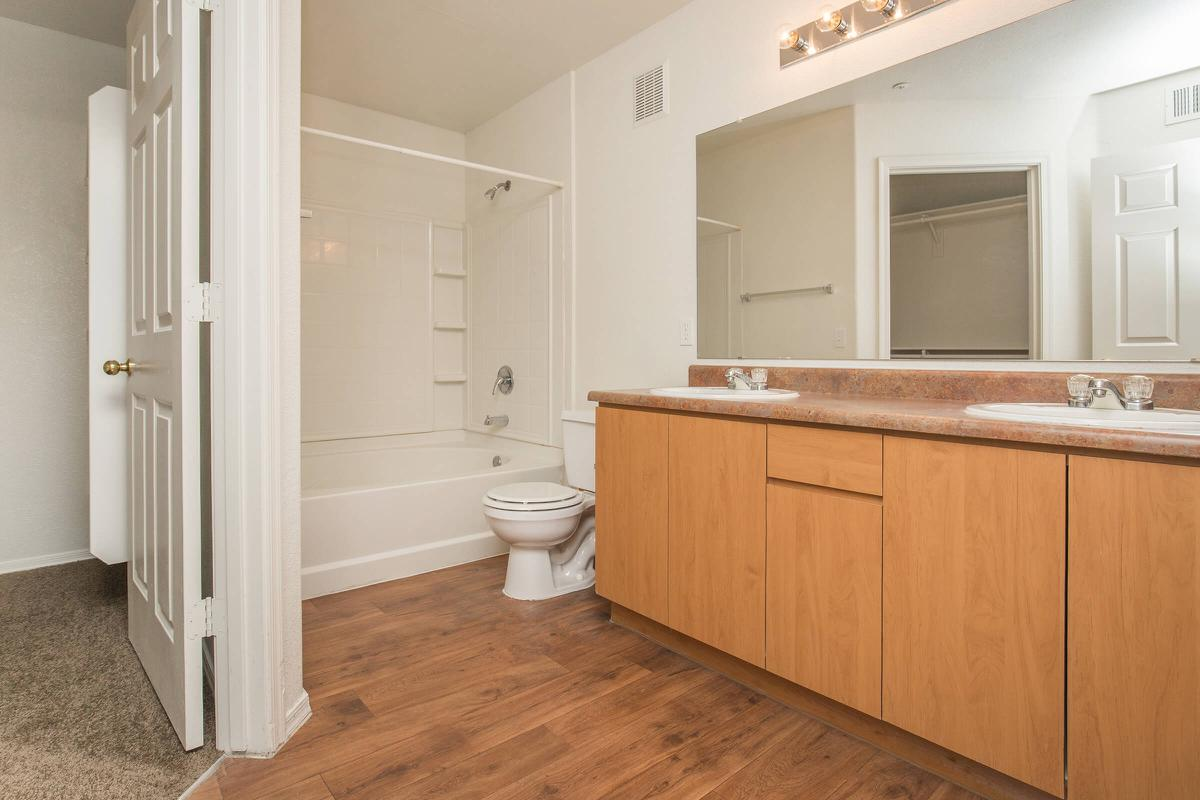 a large white tub next to a door