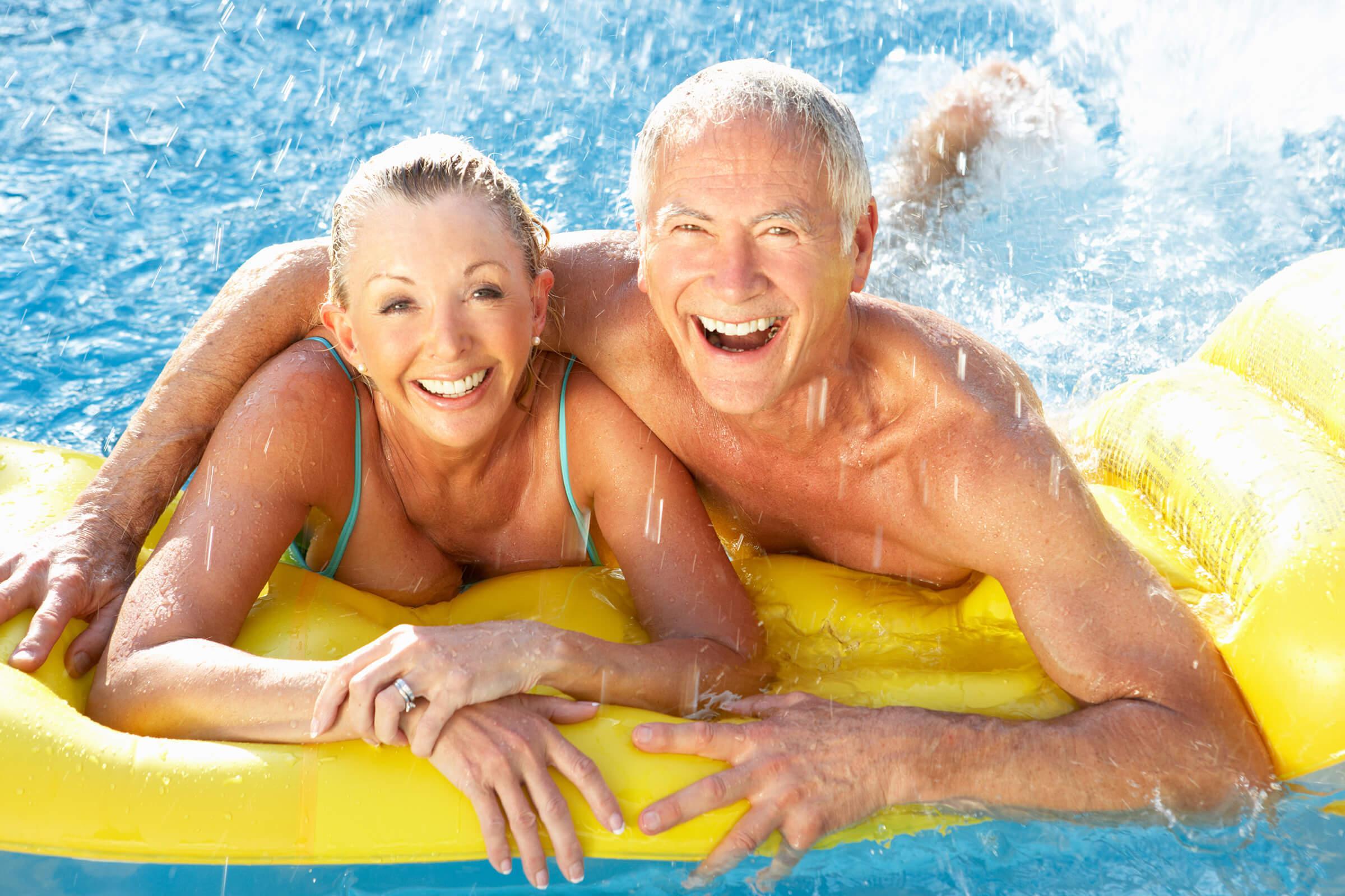 Senior couple having fun in pool iStock-121028974.jpg