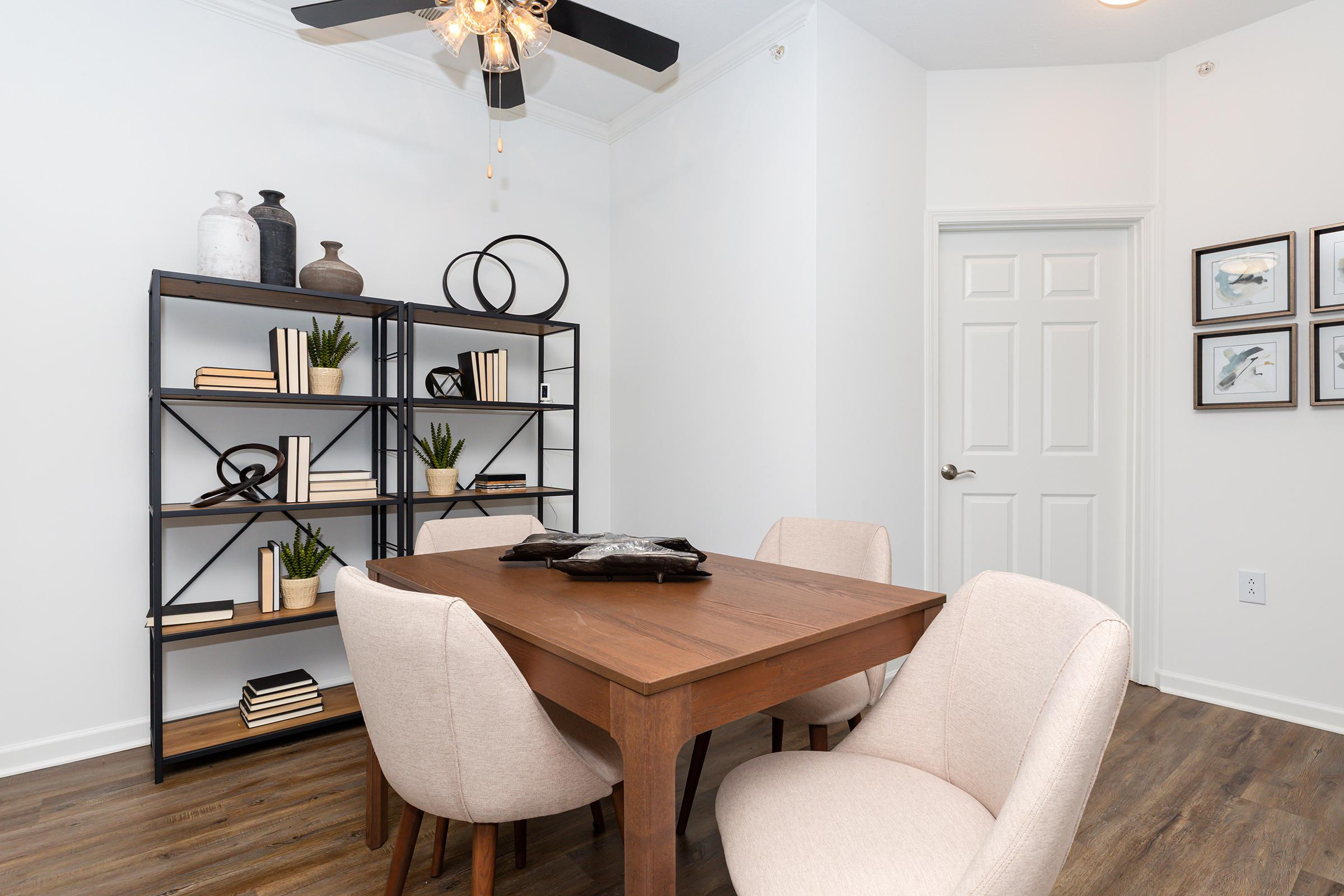 a bedroom with a desk and chair in a room
