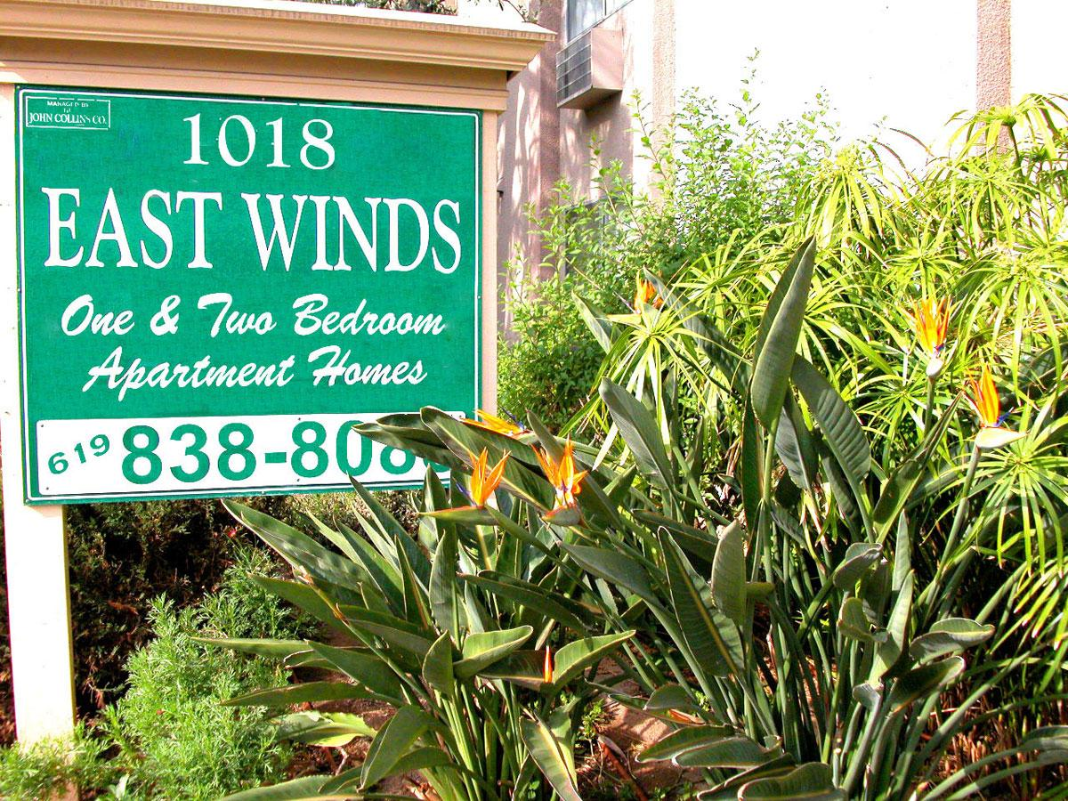 a sign in front of a green plant