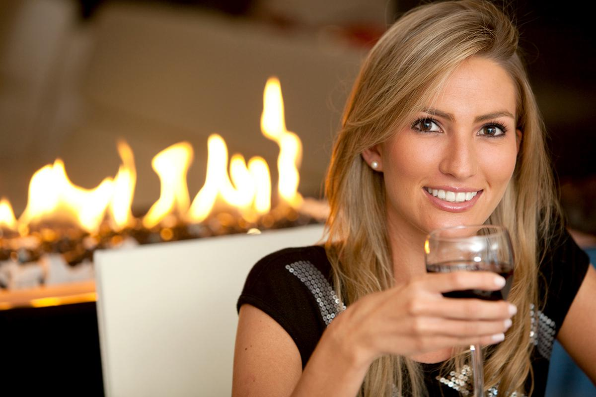 a woman holding a wine glass posing for the camera