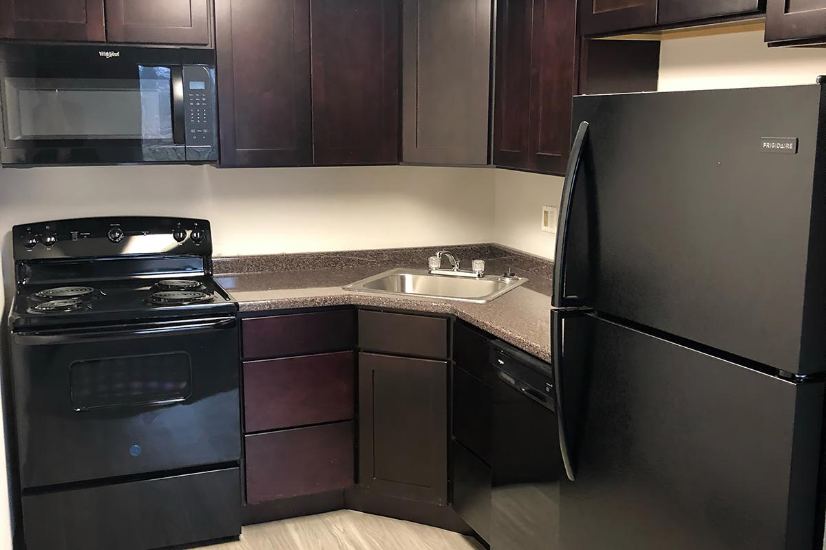 a kitchen with a stove microwave and refrigerator