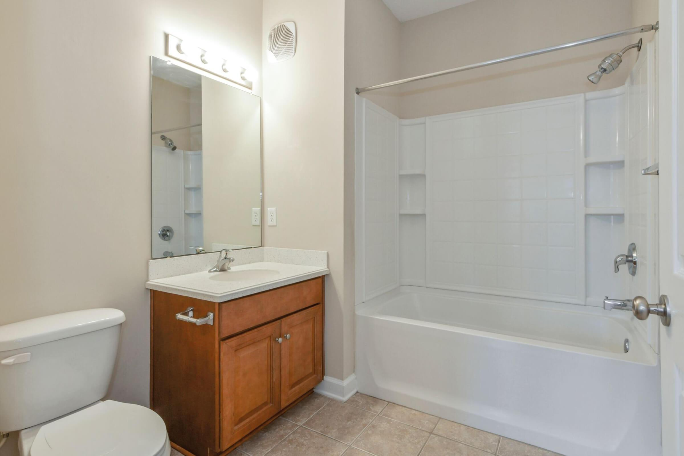 a large white tub sitting next to a shower
