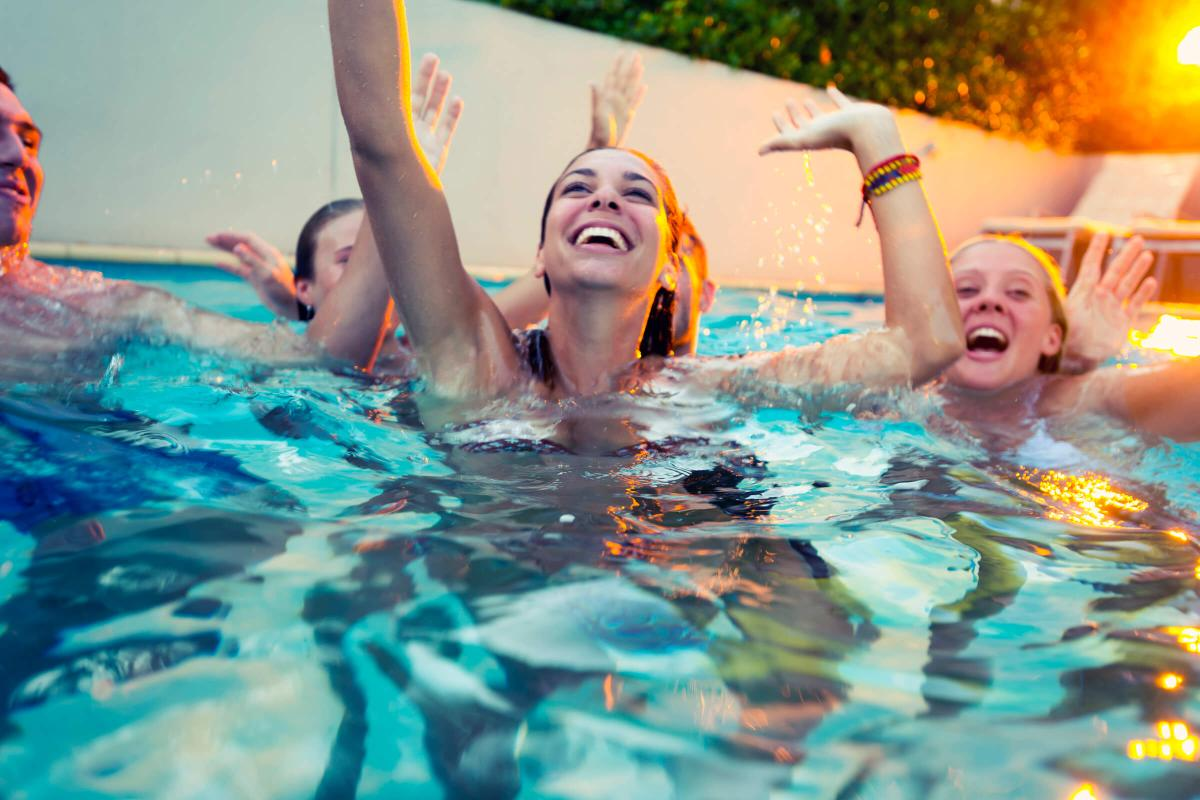 a group of people swimming in a pool of water