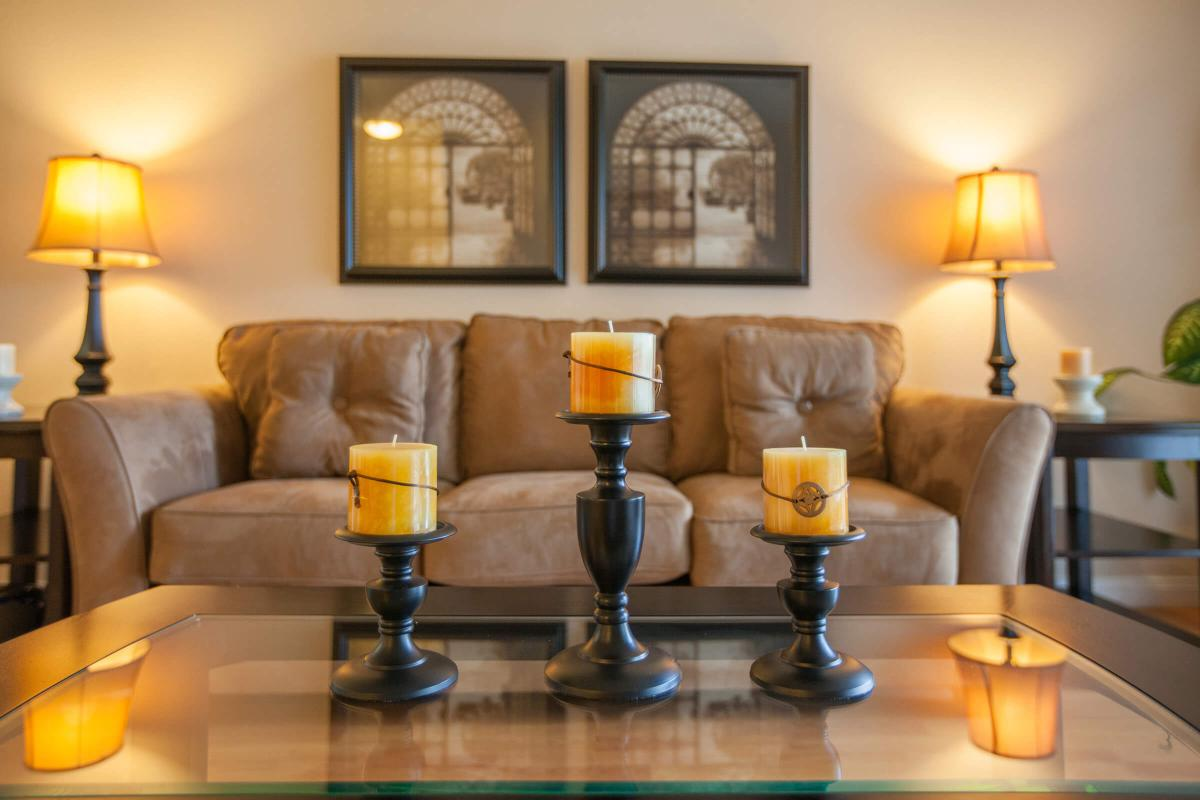 a living room next to a glass of orange juice