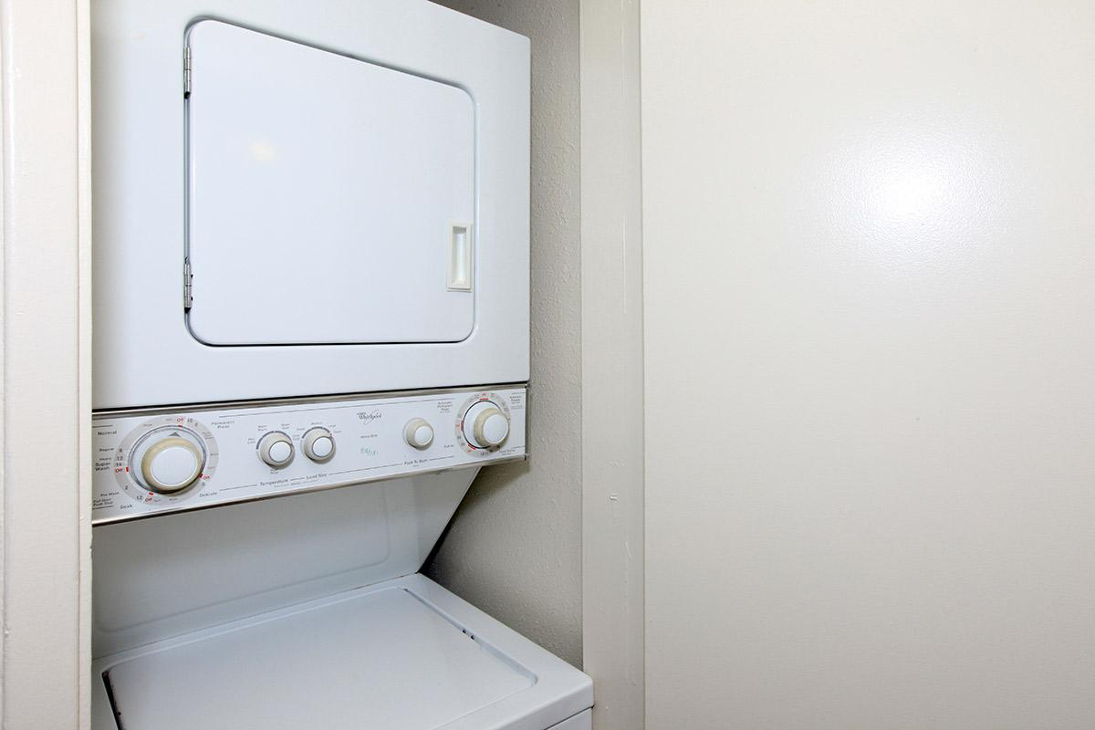 a white microwave oven sitting on top of a door