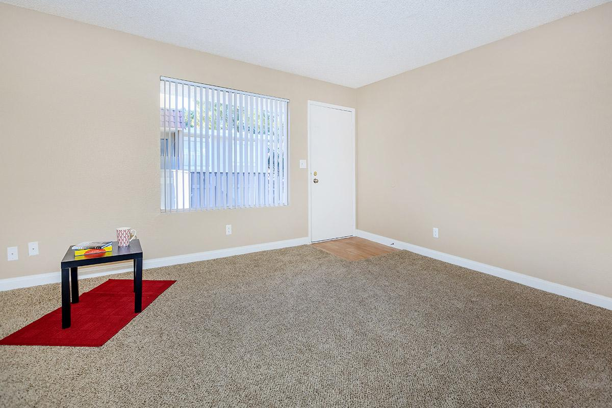 a large empty room with red floor