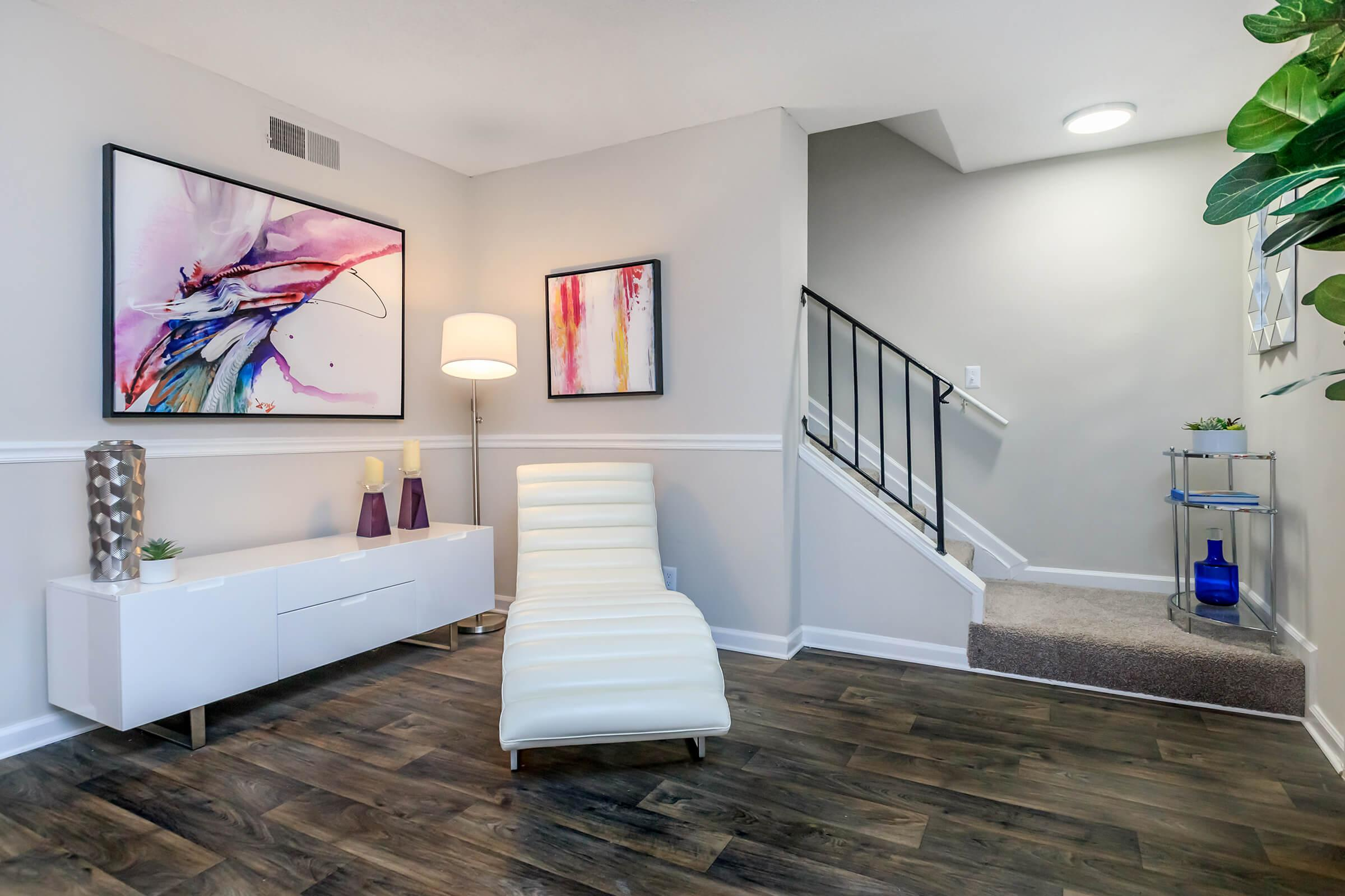 a living room with white walls