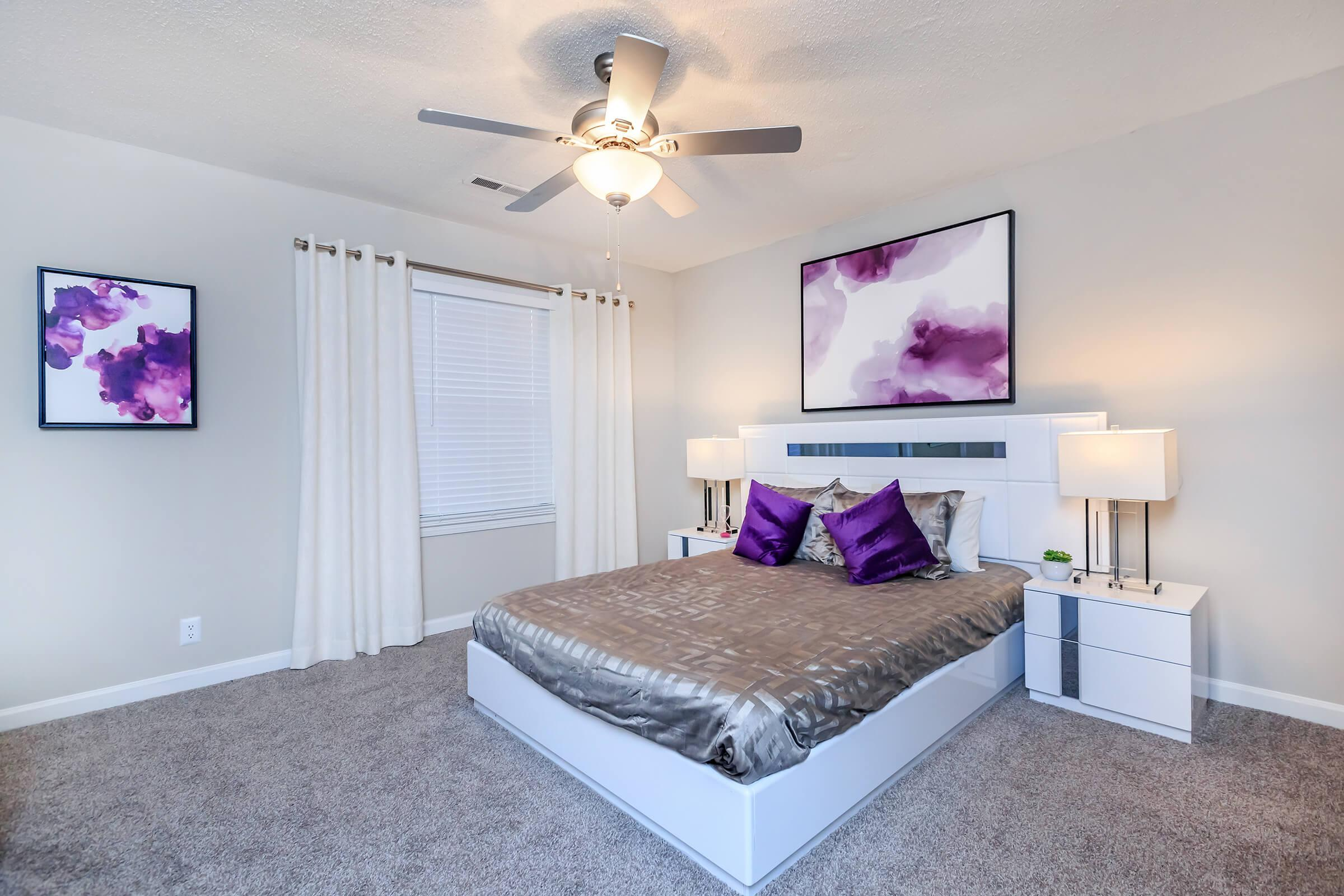 a bedroom with a bed and a flat screen tv