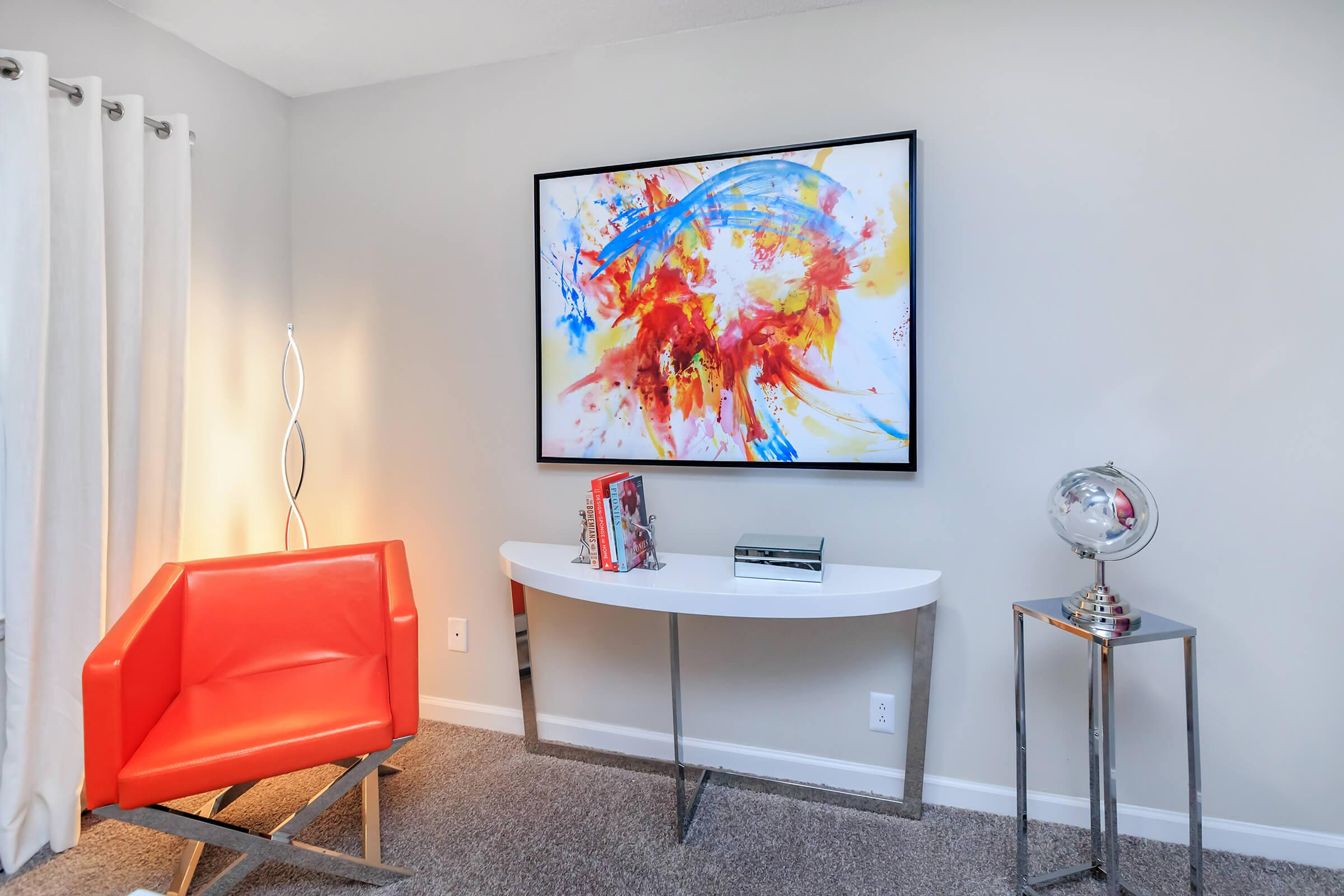 a flat screen tv sitting in a chair in a room