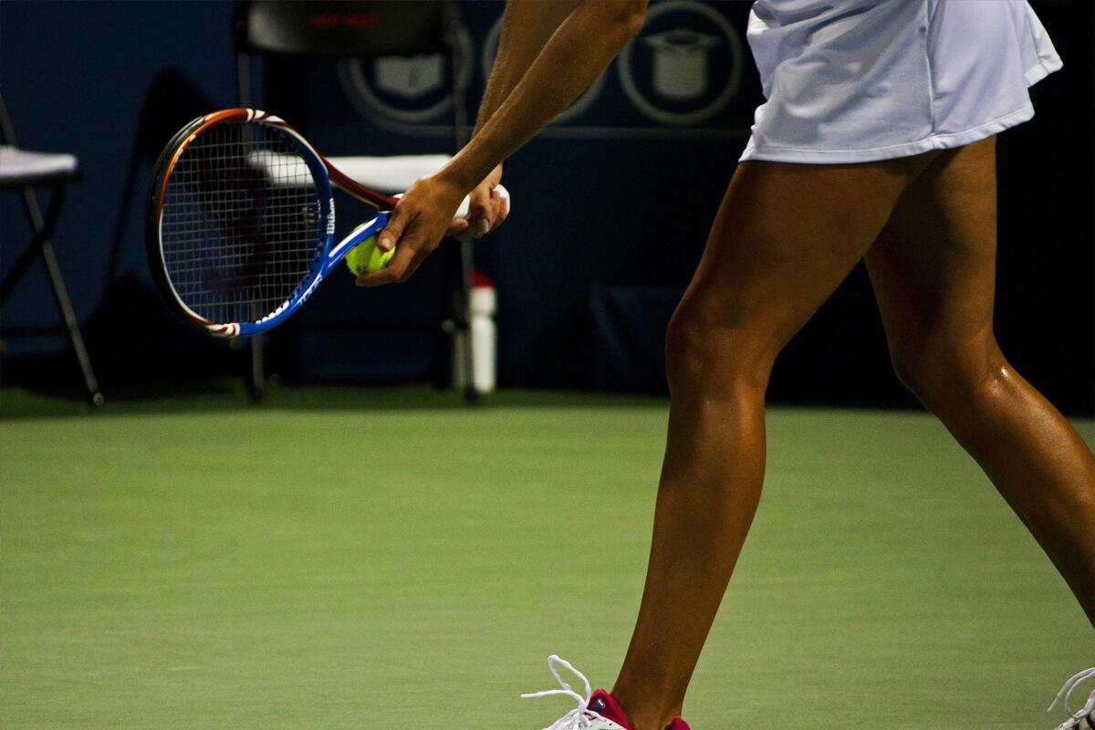 a woman with a racket on a court