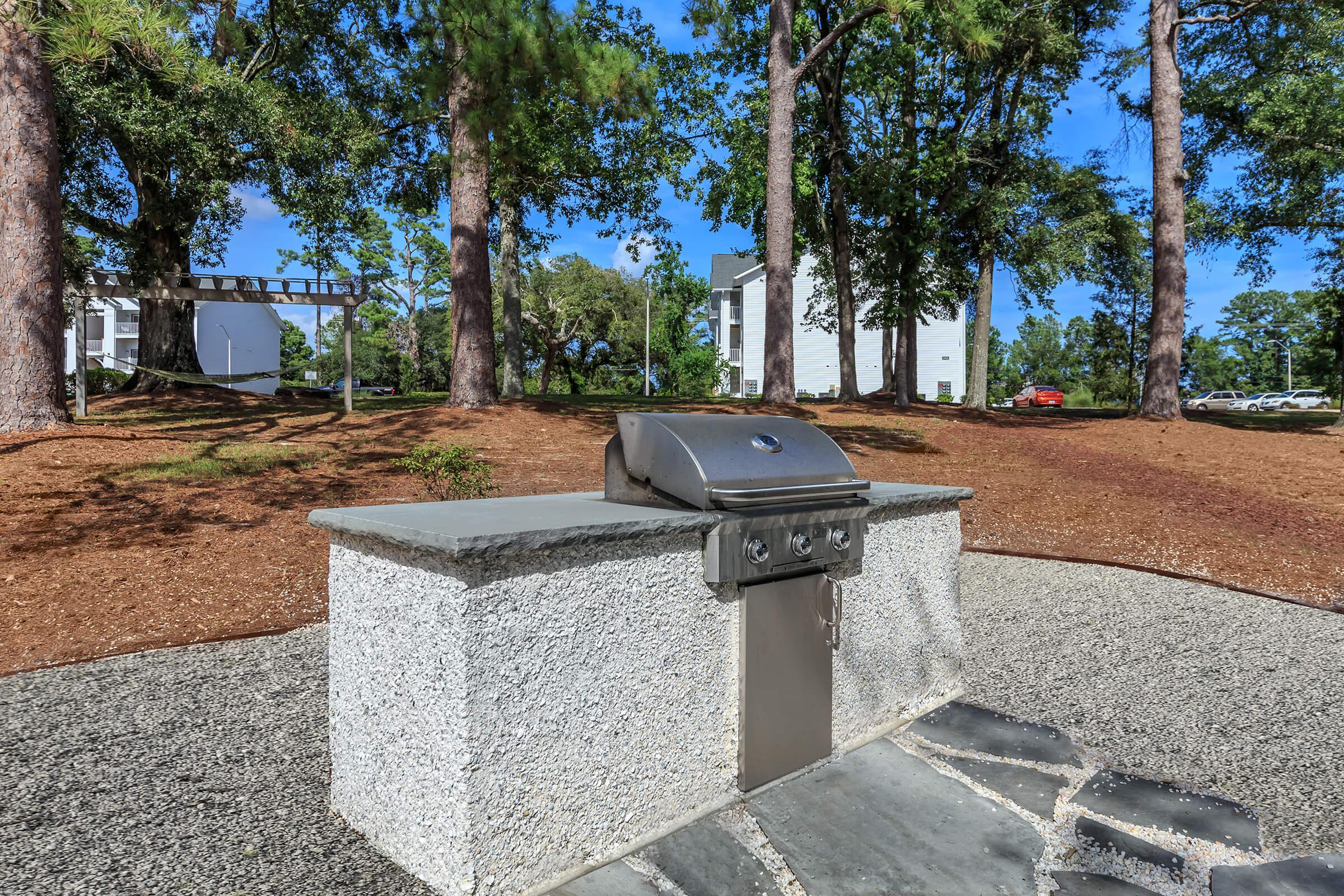 a statue of a cement bench