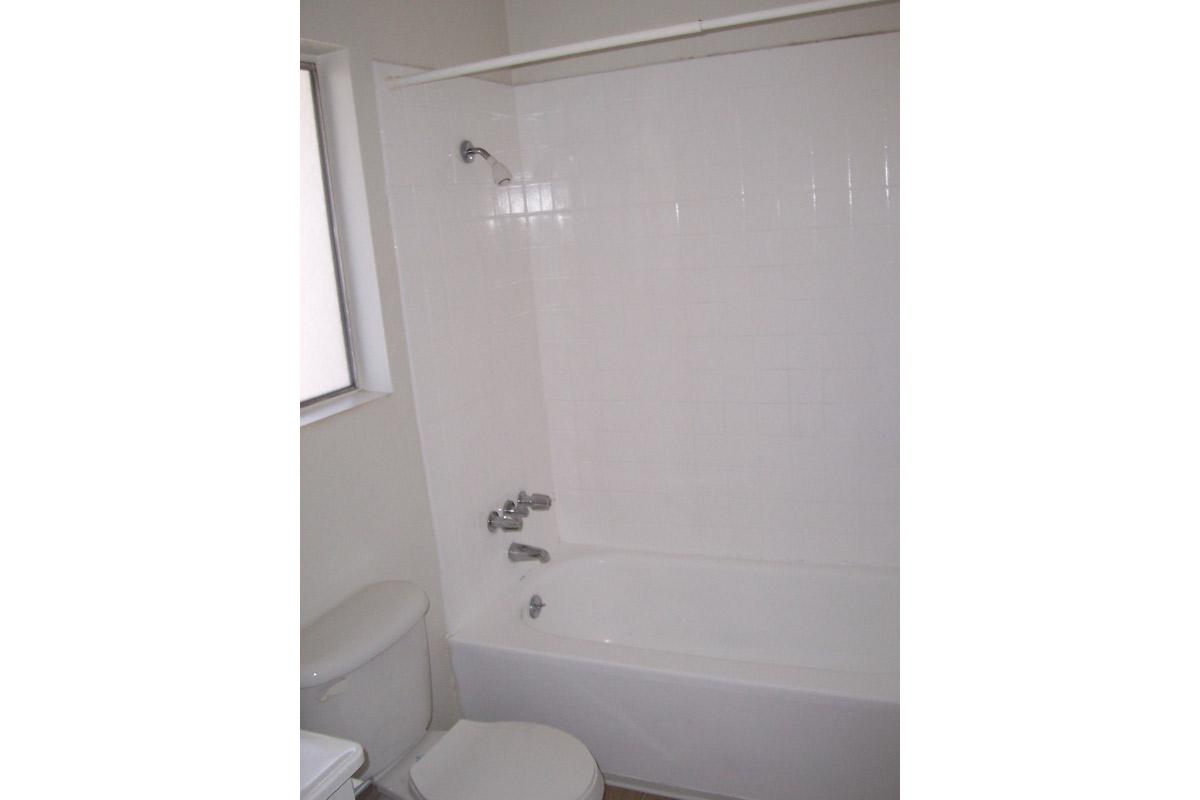 a white tub sitting next to a shower