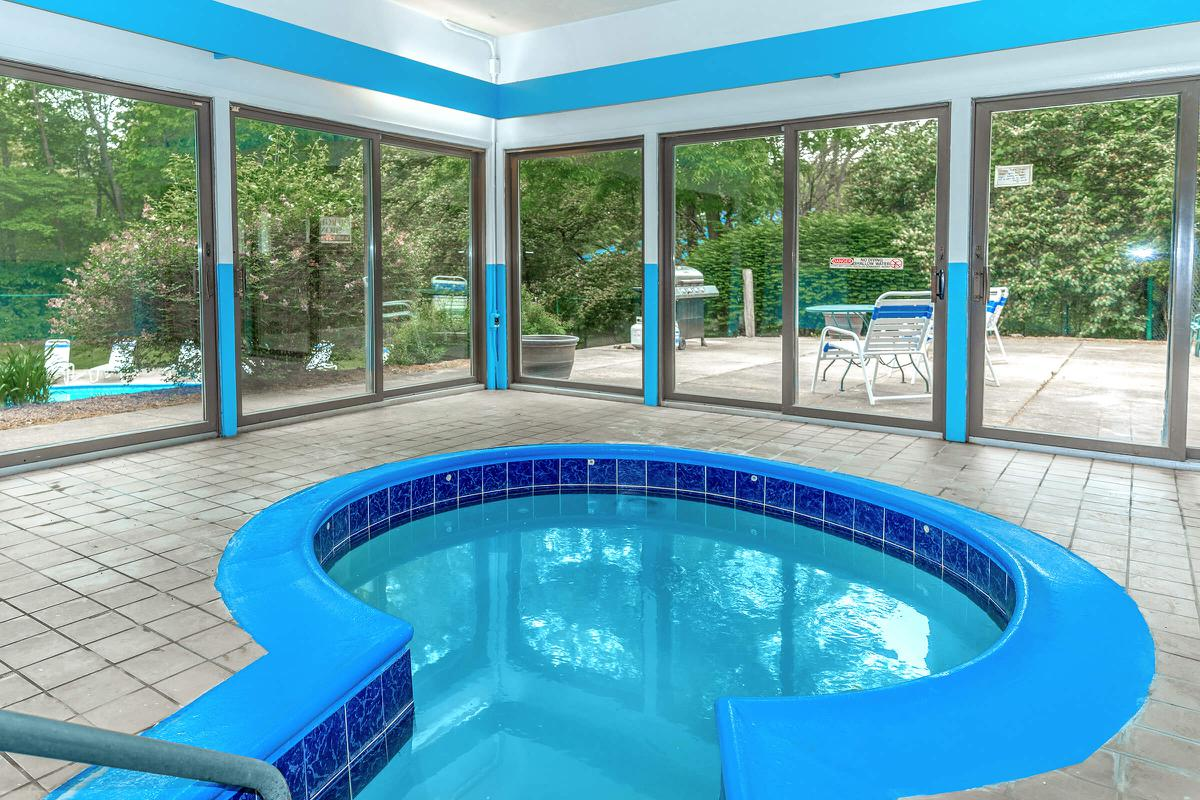 a blue chair in a pool