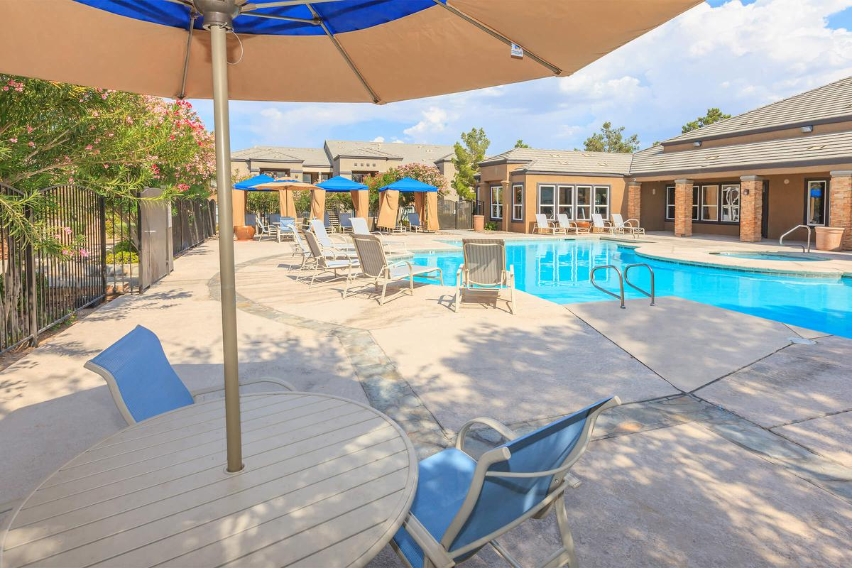 Seating by the pool at Pinehurst Condominiums Luxury Rentals
