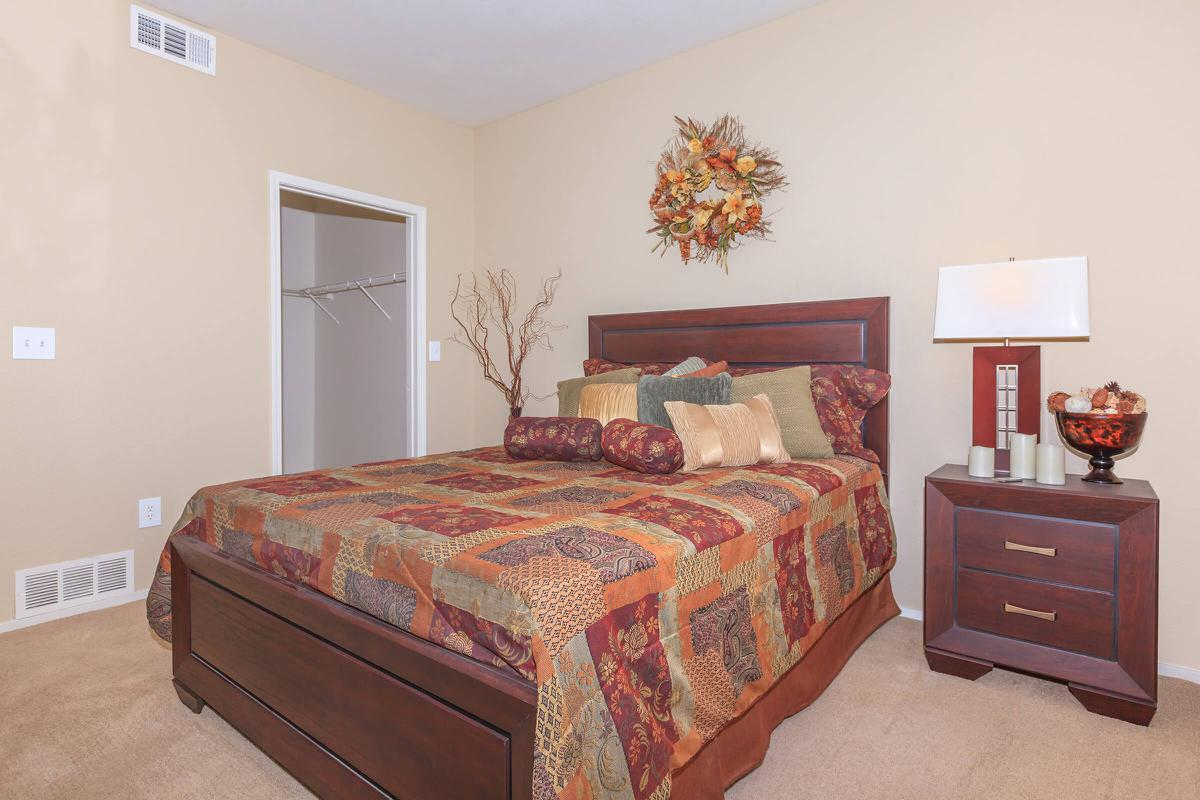 A cozy bedroom at Pinehurst Condominiums Luxury Rentals