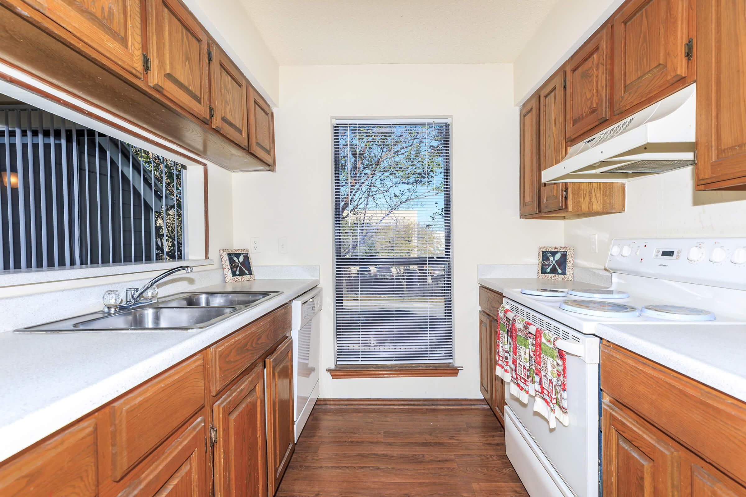 a kitchen with wooden cabinets and a window