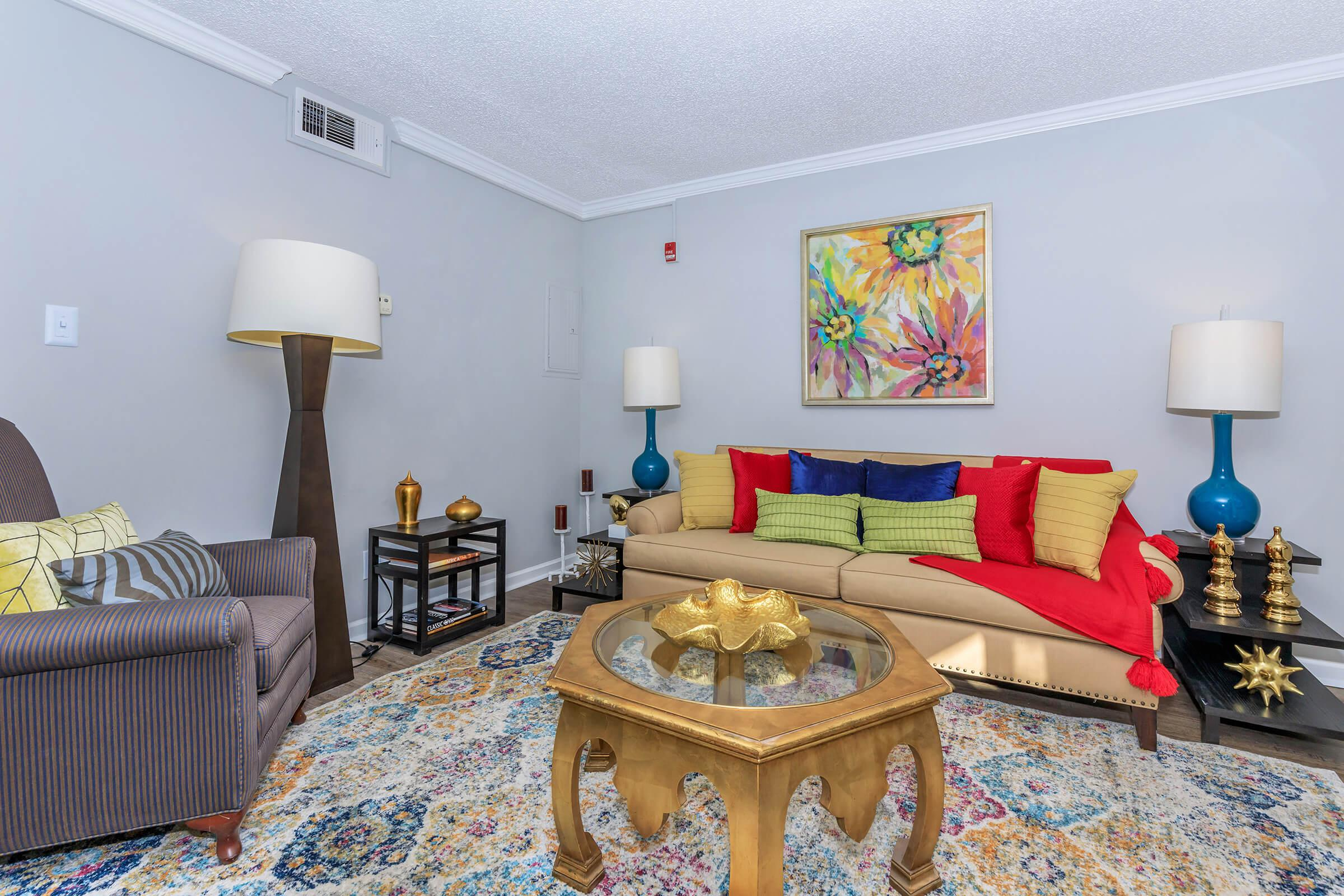 YOUR LIVING ROOM AT KINGSTON POINTE APARTMENTS