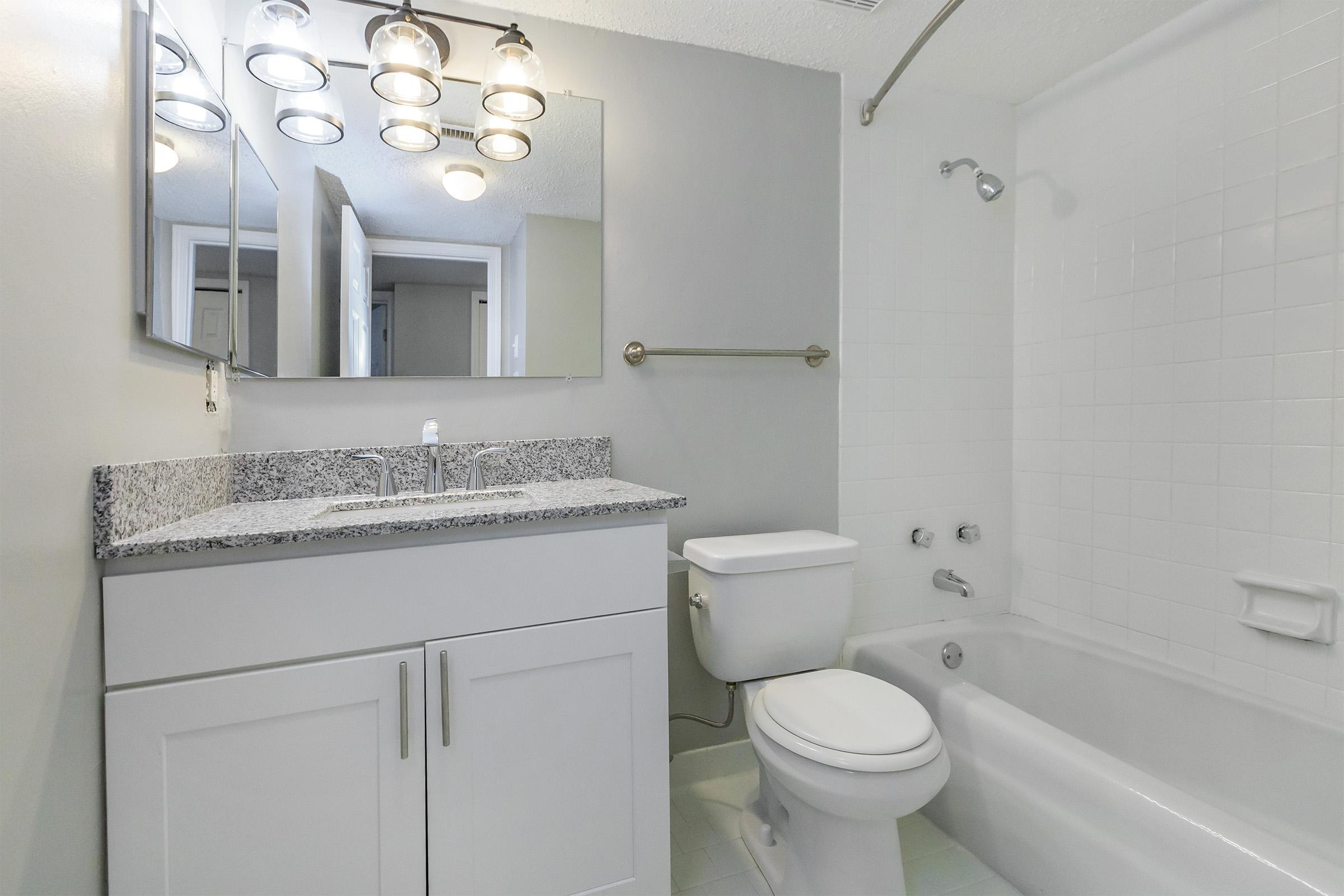 BATHROOM AT KINGSTON POINTE APARTMENTS