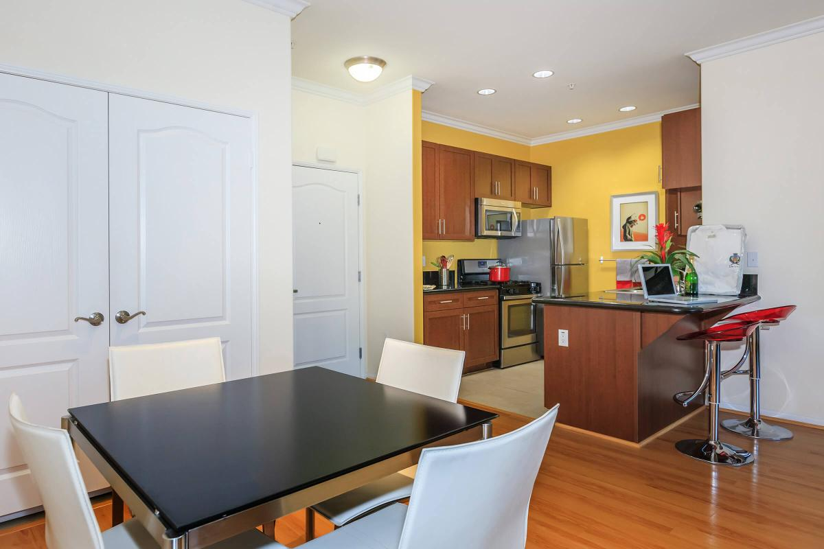 a kitchen with a dining room table
