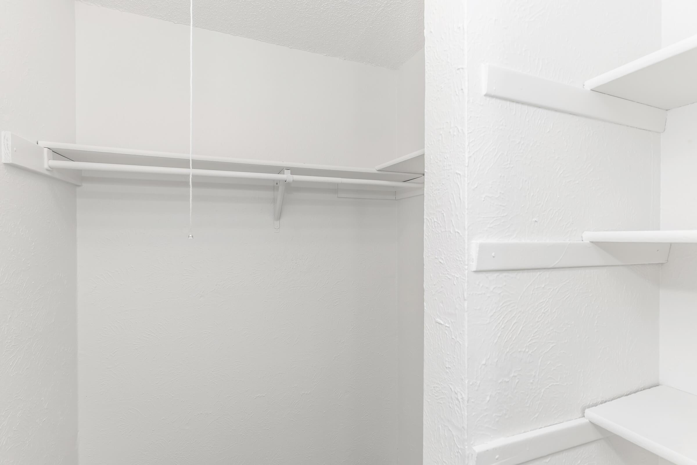 a white refrigerator freezer sitting next to a shower