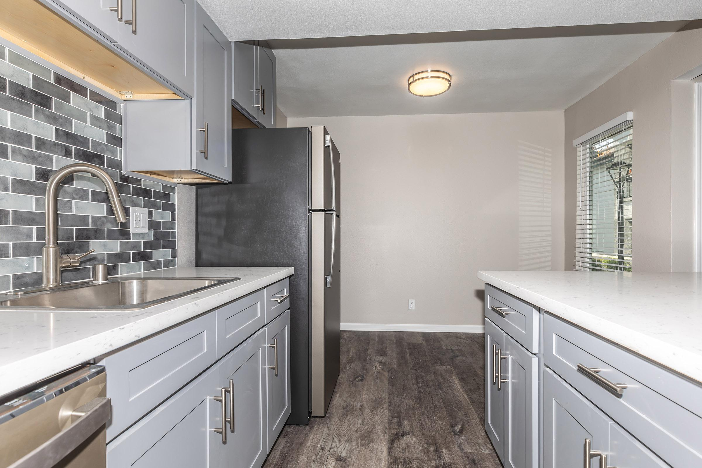 Kitchen at Enclave at Town Square Apartments in Chino, CA