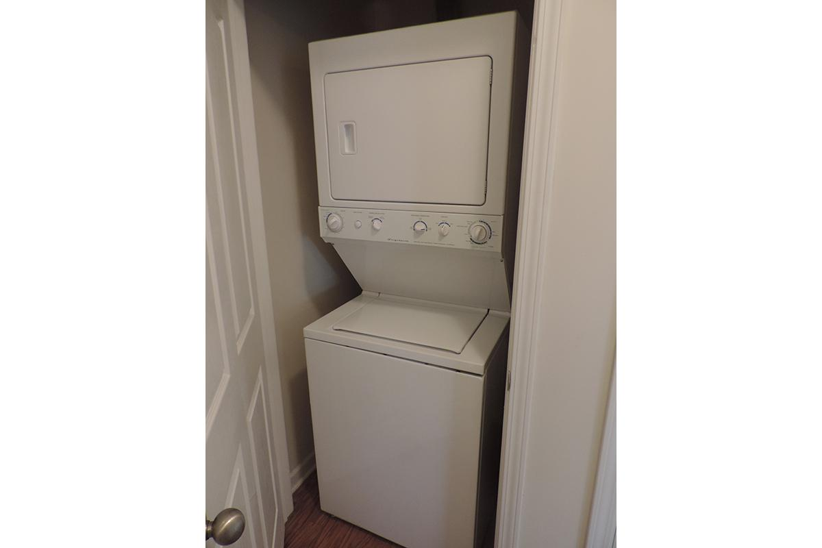 a white refrigerator freezer sitting in a box