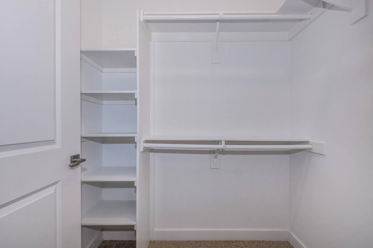 a white refrigerator freezer sitting next to a shower