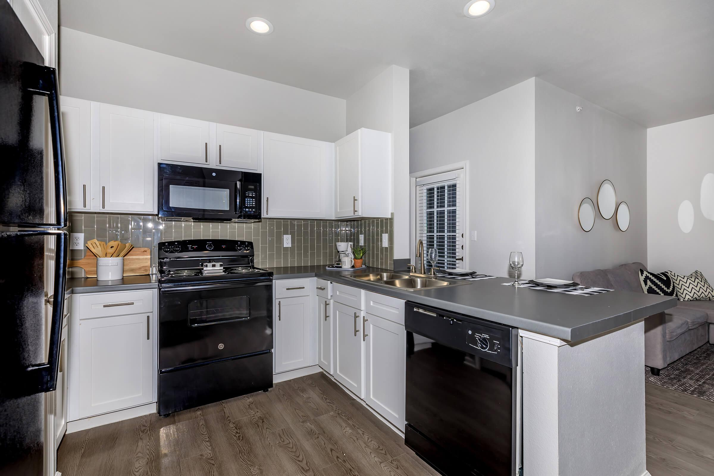 a large kitchen with stainless steel appliances