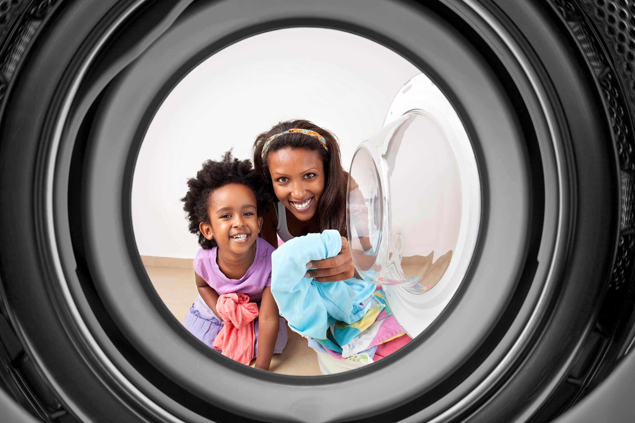 a washer in front of a mirror posing for the camera