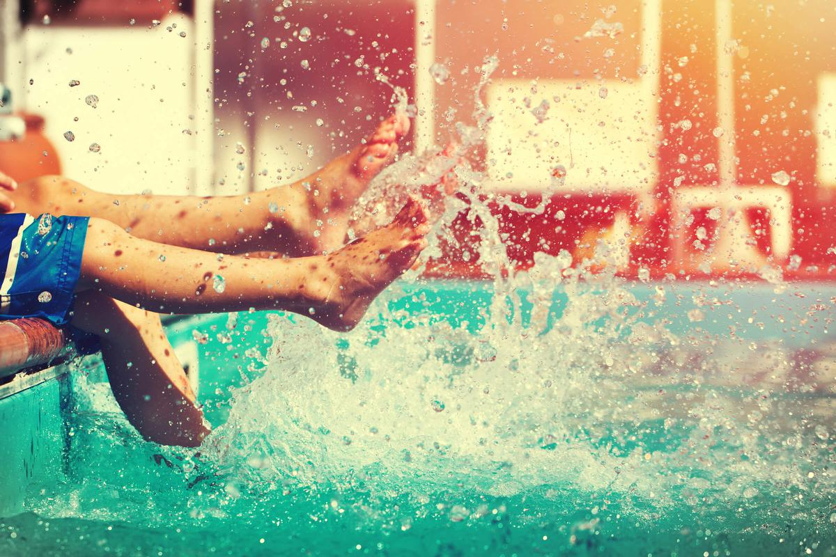 Boys legs splashing water in pool vintage iStock-647555920.jpg