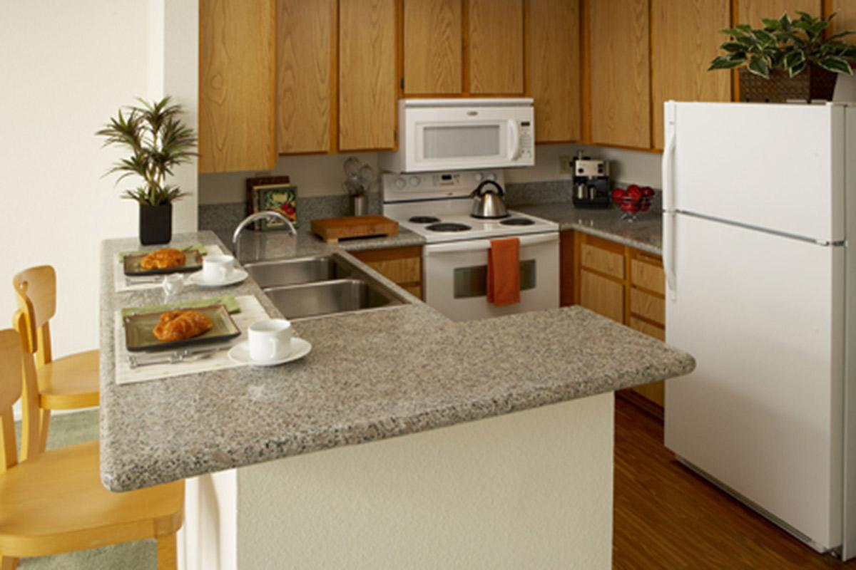 Granite countertops are the perfect accent for your chic new kitchen.