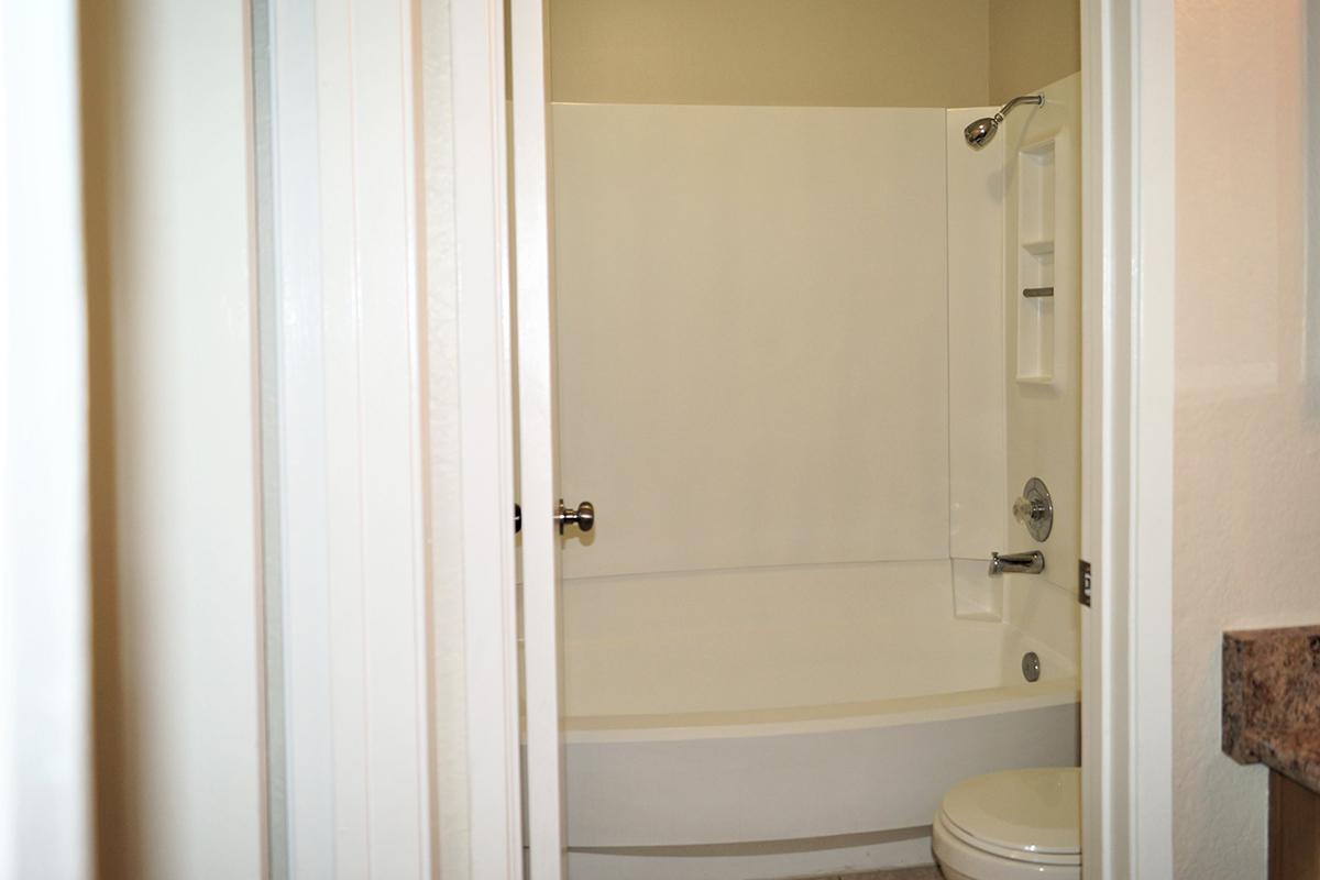 a white tub sitting next to a door