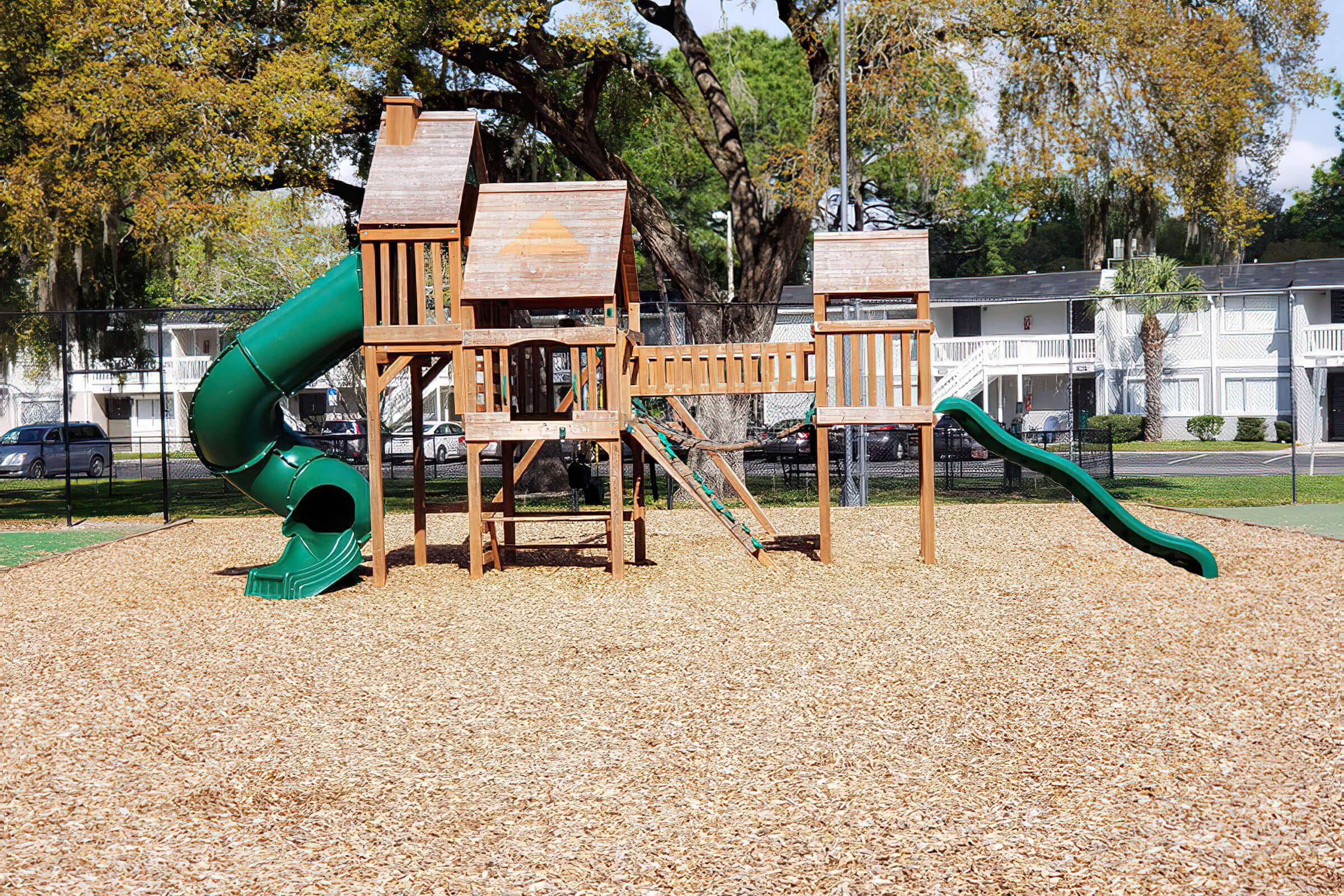 a playground in front of a green chair