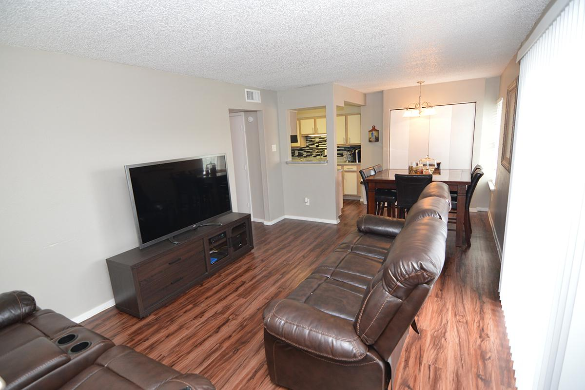 a living room with hard wood floors