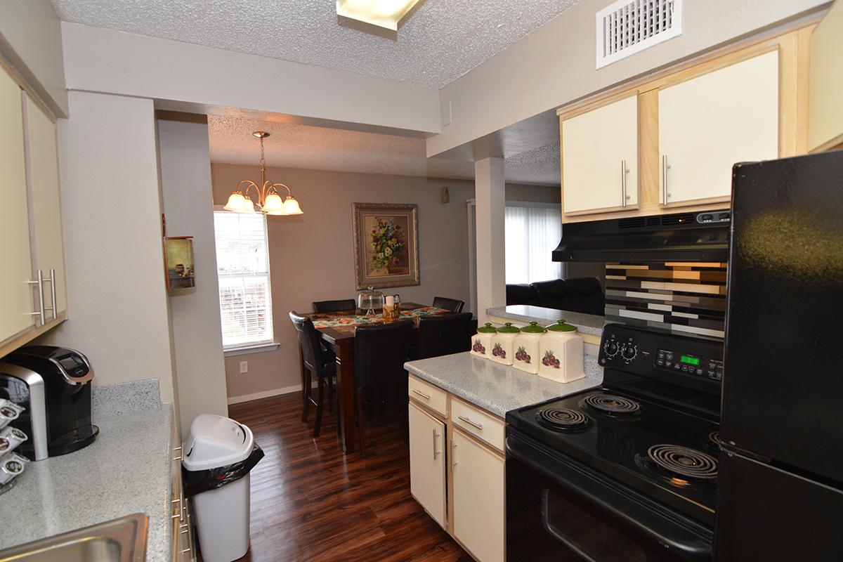 a kitchen with a stove top oven sitting inside of a room