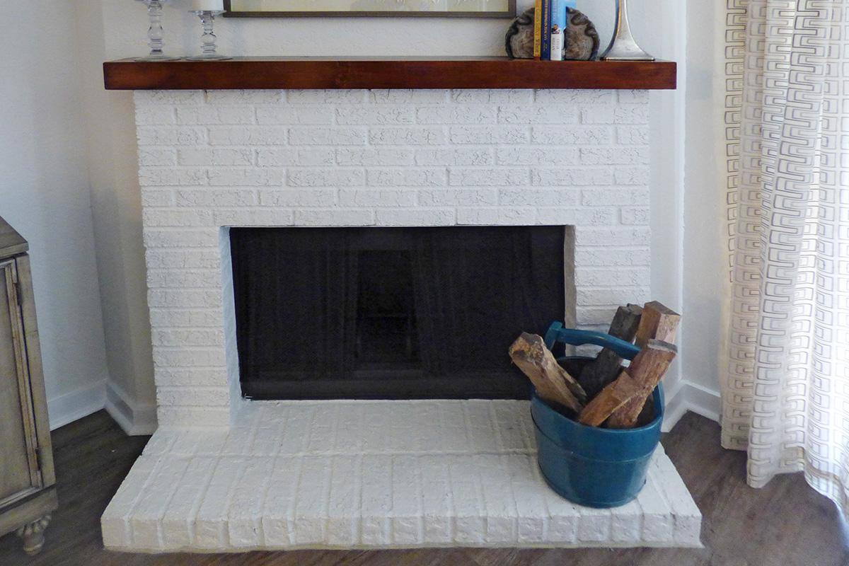 a close up of a fire place sitting in a room