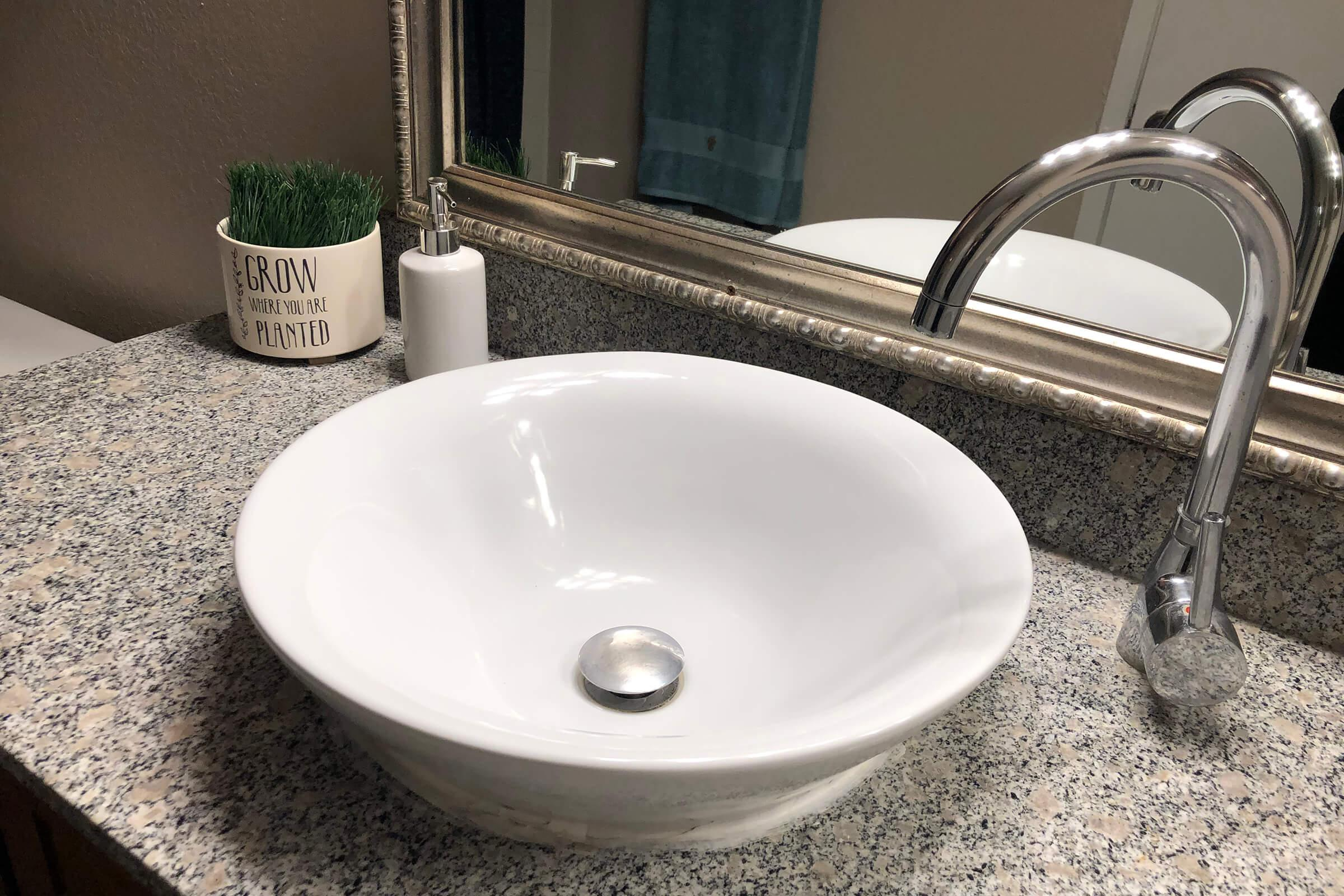 a close up of a bowl sink