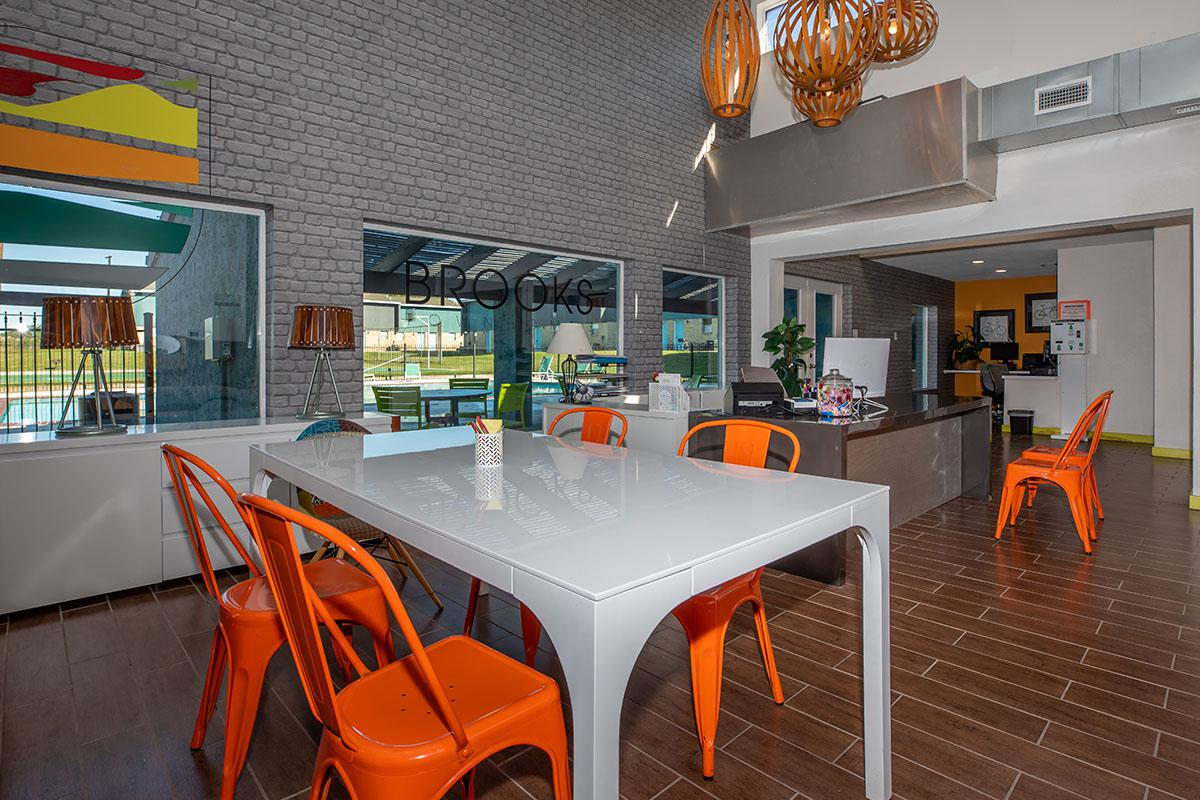 a kitchen with an orange umbrella