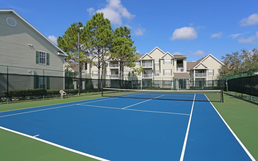 a building with a racket on a court