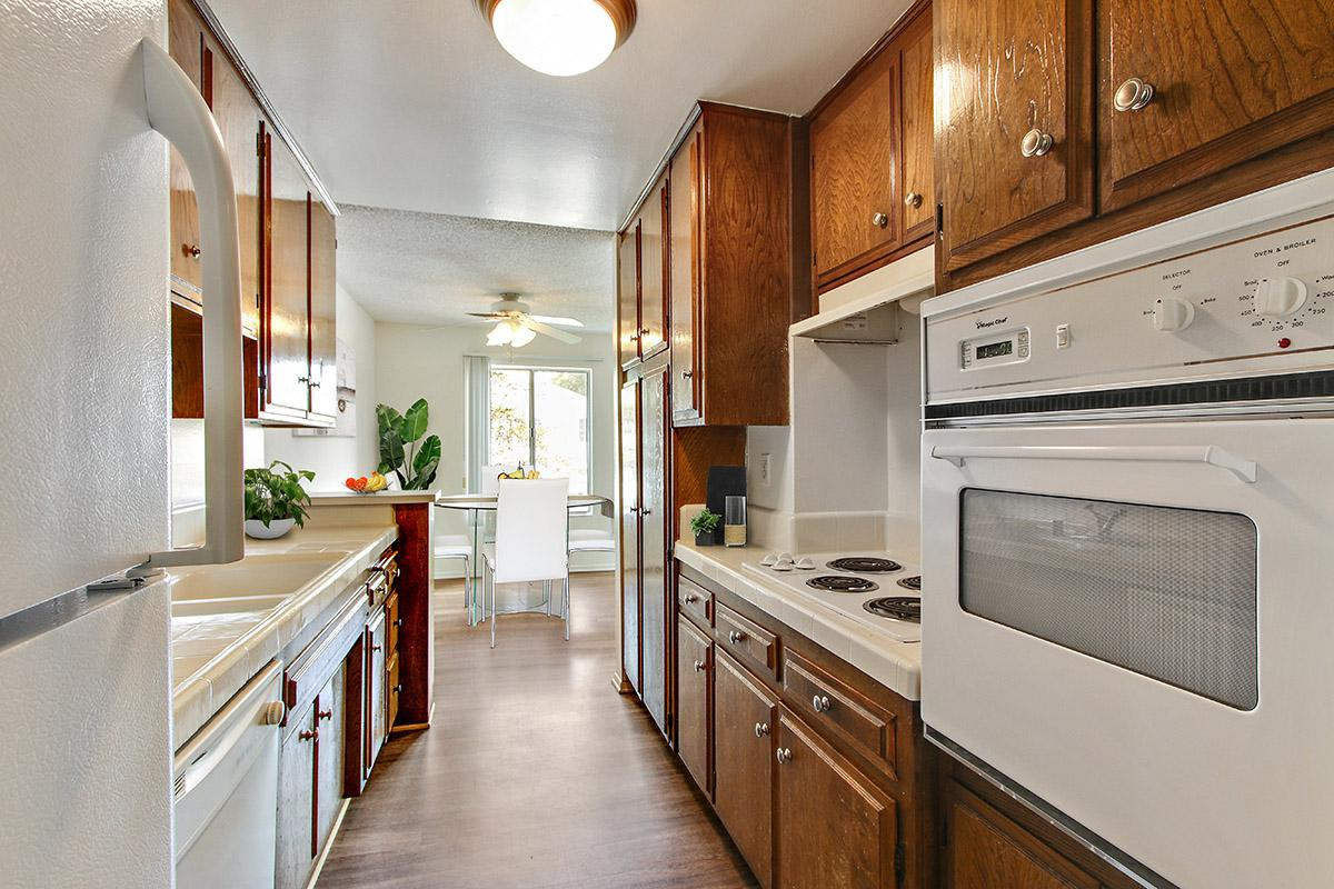a kitchen with a stove top oven sitting inside of a refrigerator