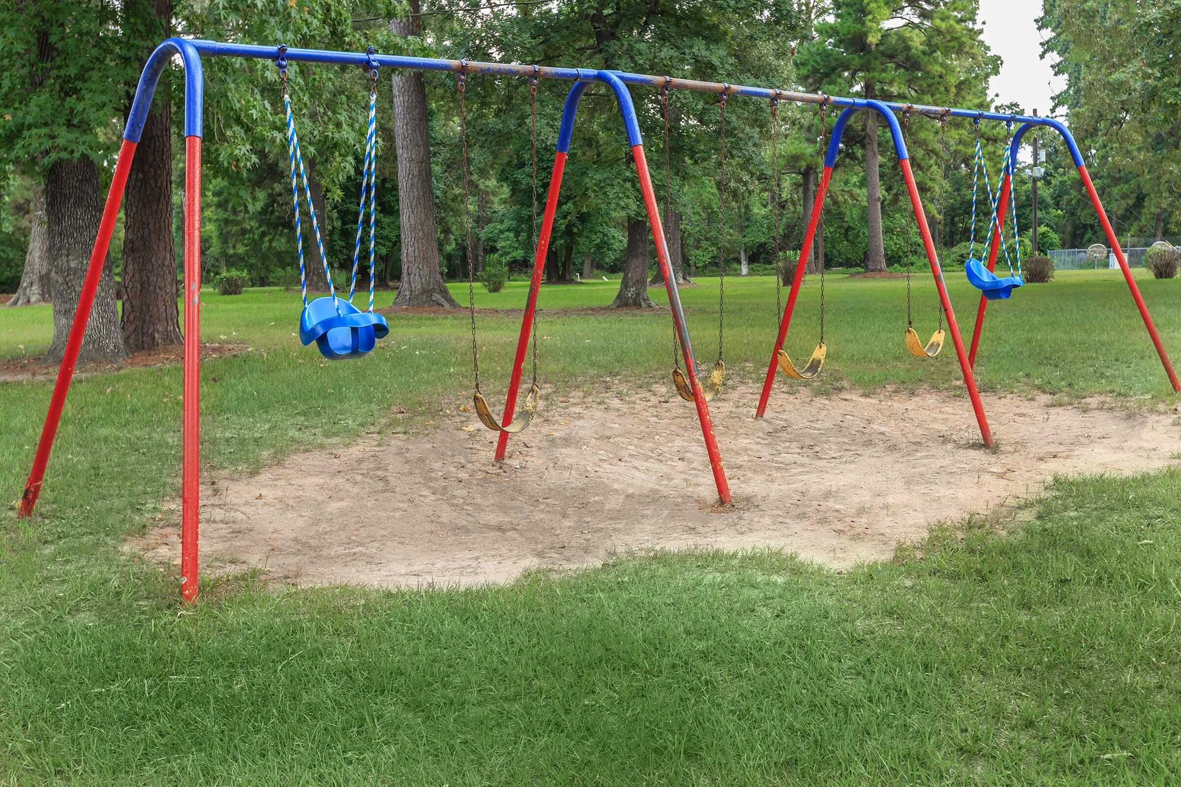 a swing set in a park