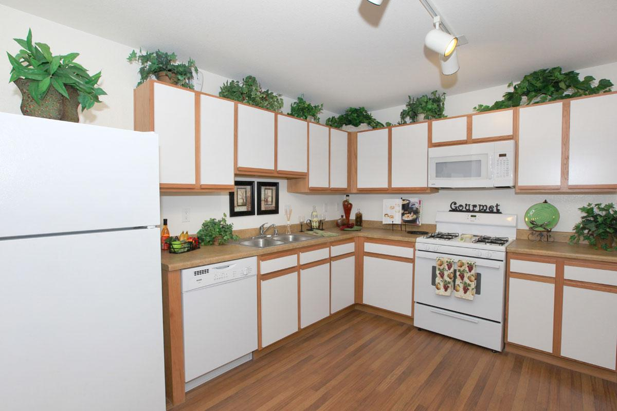 a modern kitchen with wood cabinets