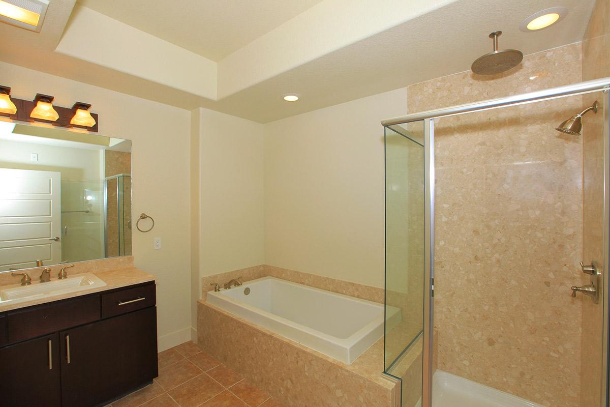 TILED SHOWERS AND BATHTUBS AT ECHELON AT CENTENNIAL HILLS IN LAS VEGAS