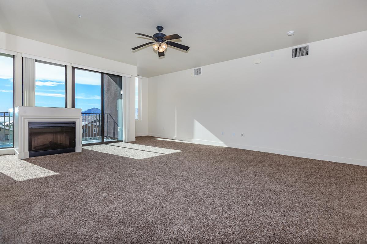 CARPETED FLOORS, CEILING FANS,  AND FIREPLACE AT ECHELON AT CENTENNIAL HILLS IN LAS VEGAS