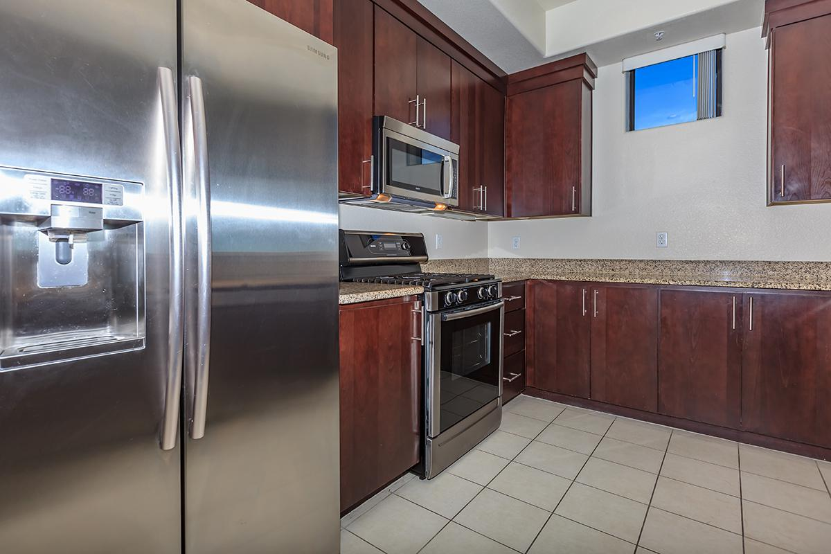 STAINLESS STEEL APPLIANCES AND UPGRADED CABINETS AT ECHELON AT CENTENNIAL HILLS IN LAS VEGAS