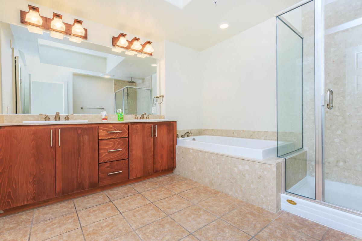 TILED BATHROOMS WITH DESIGNER FIXTURES AT ECHELON AT CENTENNIAL HILLS IN LAS VEGAS