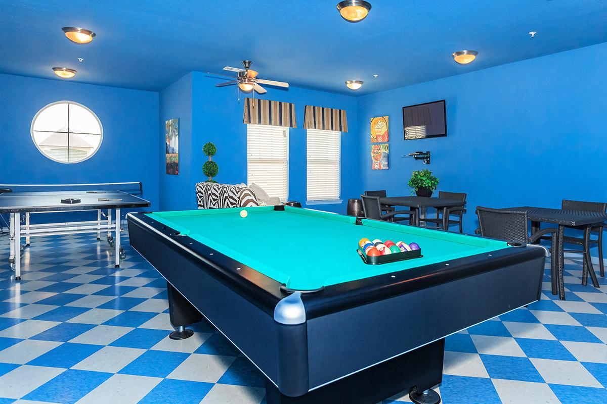 a room with a blue ball on the floor