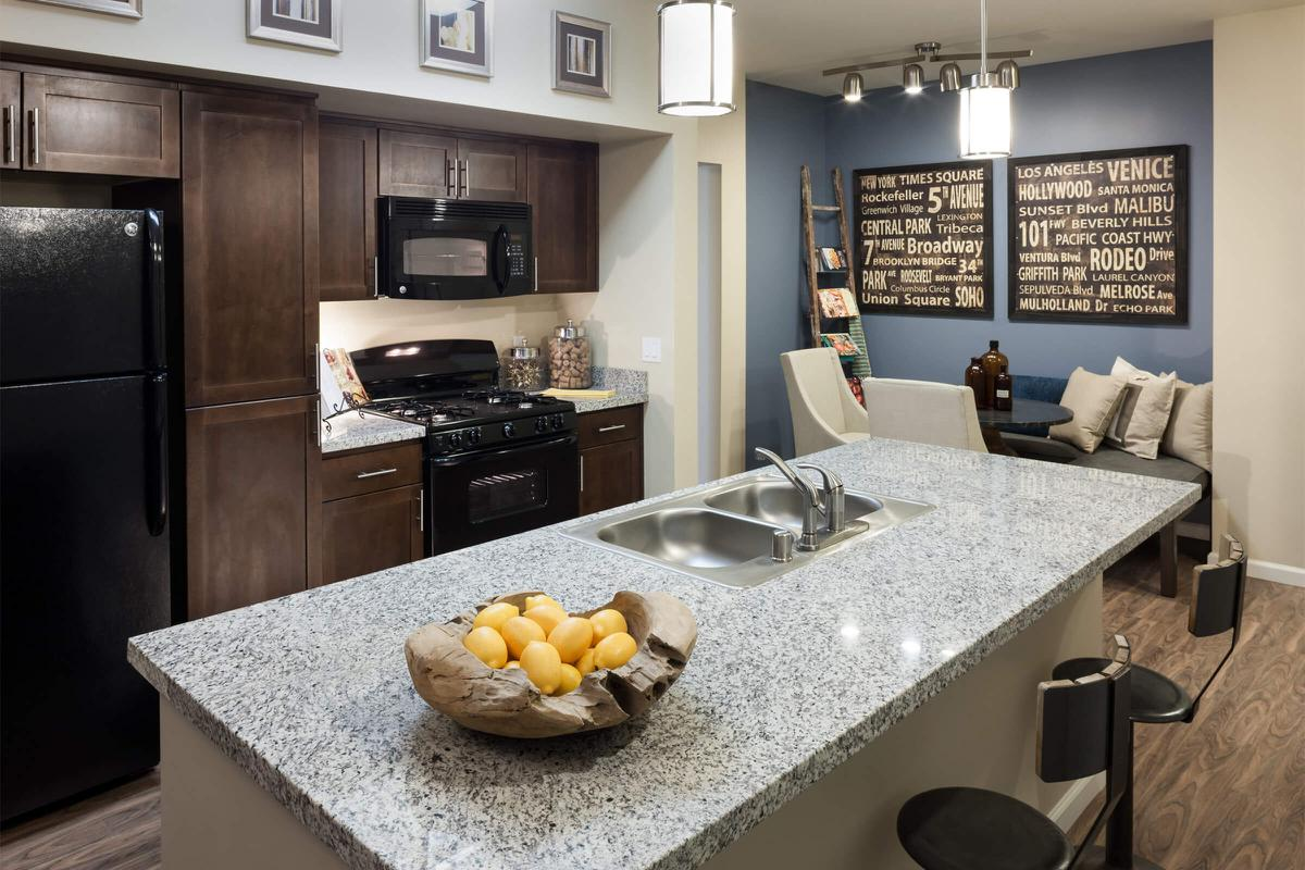 Kitchen with a dining room table in the background