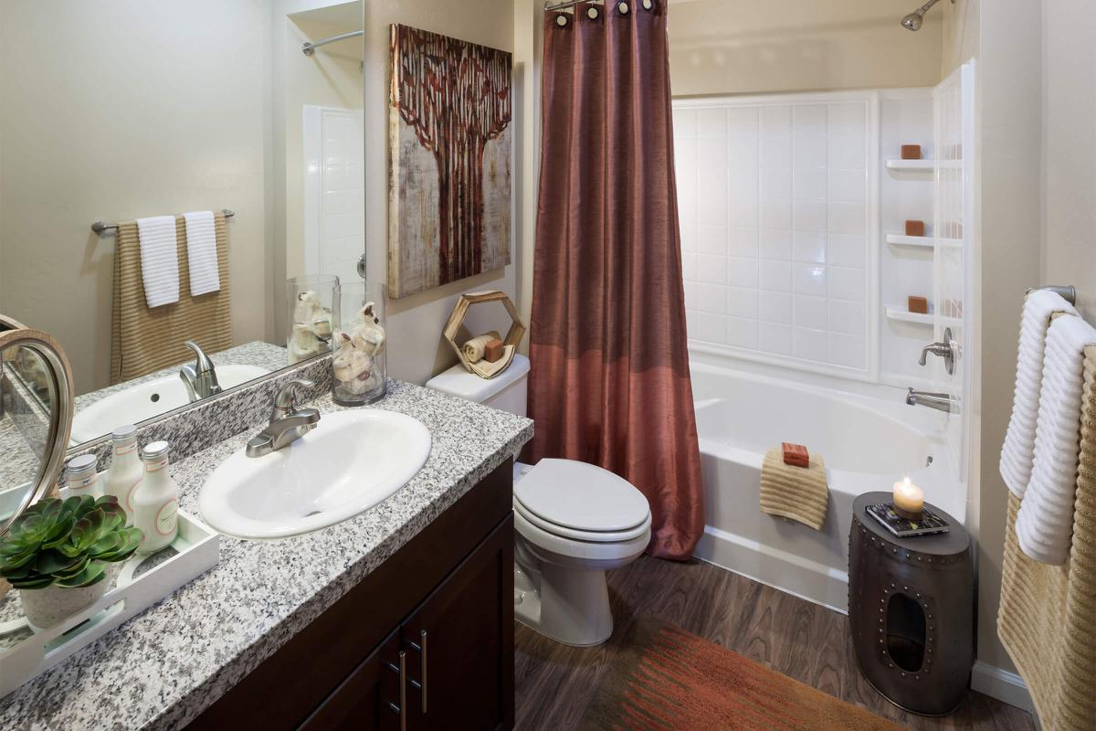 Bathroom with red shower curtain